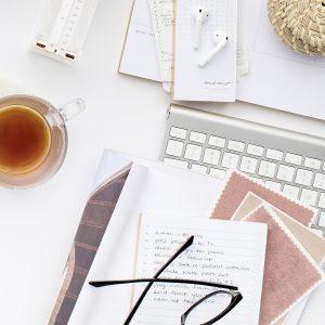 Desktop with planner, calendar, list and tea