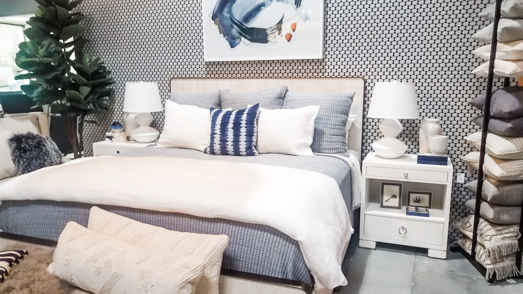 Coastal chic bedroom blue and white patterned wallpaper behind a bed. Nestorations.
