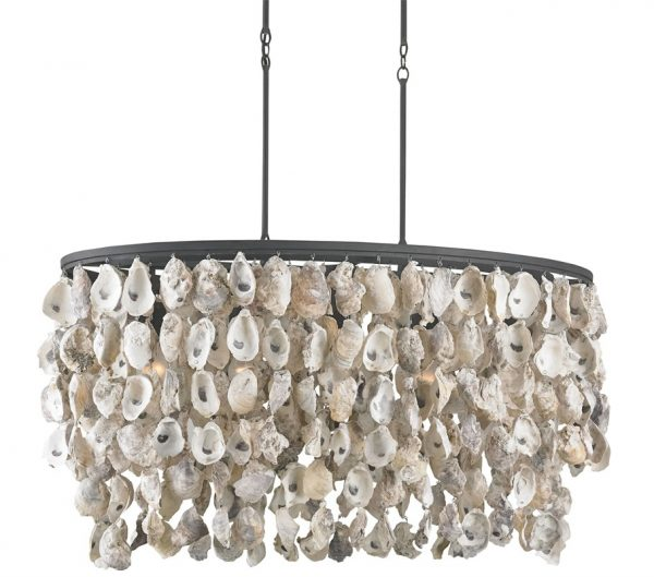 Dripping in oyster shells the Stillwater chandelier by Currey and Company is perfect for beach living.