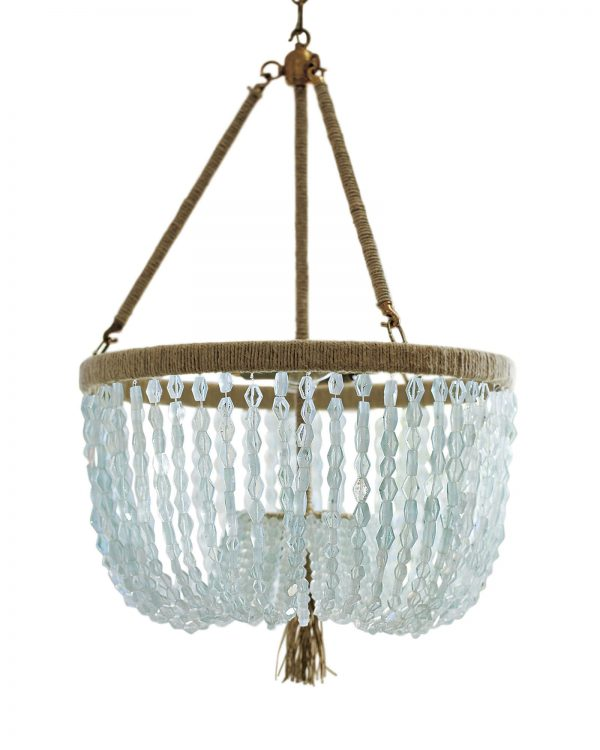 Cut seaglass beads and a hemp-wrapped frame make the Seychelles chandelier by Serena and Lily the perfect coastal accent.