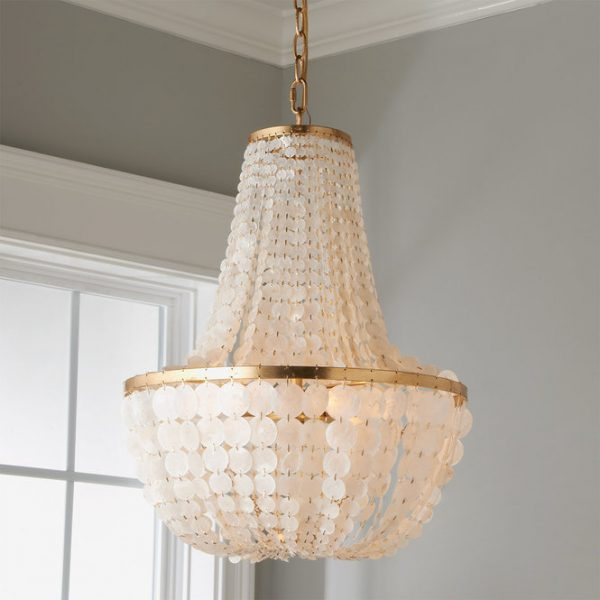 The Capiz Shell chandelier from Shades of light comes in 2 different finishes to help you get an elegant coastal look in your home.