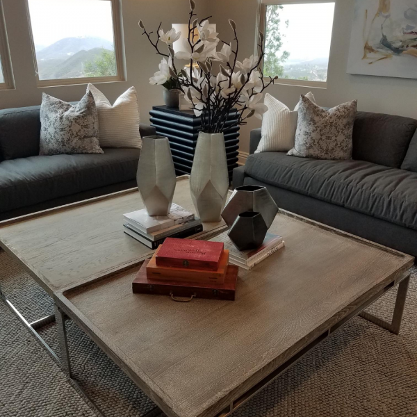 Push two coffee tables together to create one large coffee table