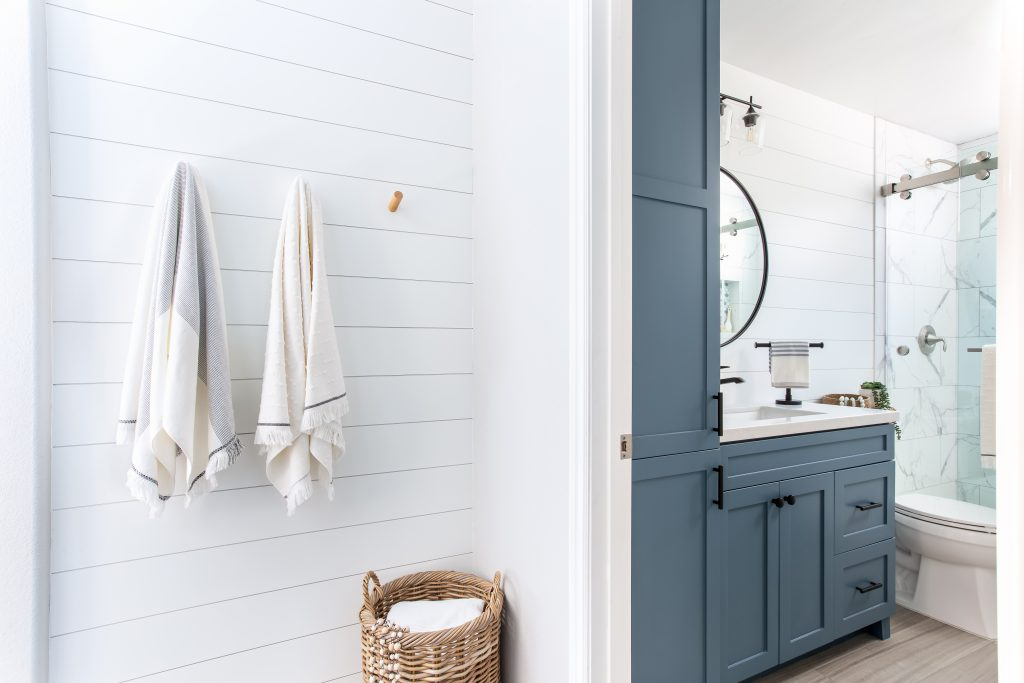 Modern farmhouse meets coastal style bathroom remodel