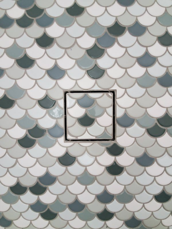 Scallop tile, mermaid scale tile in a coastal bathroom remodel
