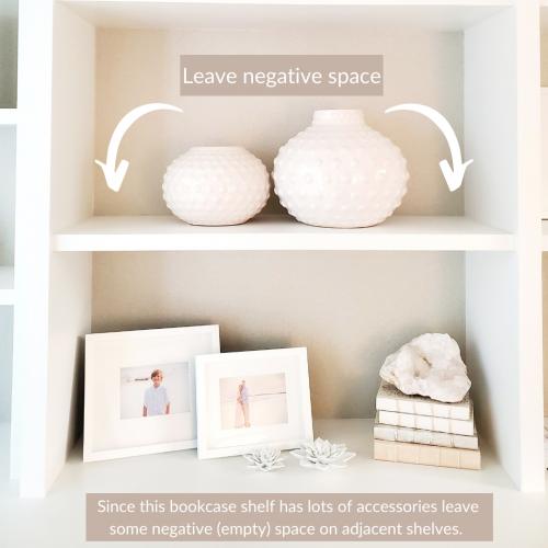 Add negative space in bookcase