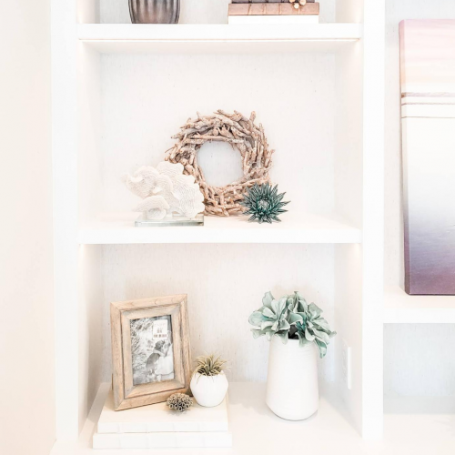 Use groups of three for bookcase styling