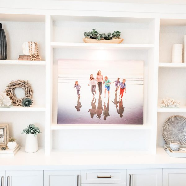 This space used to be an awkward unused nook at the back of my client's family room. We created this custom built-in bookcase that added needed storage and showcased family photos and decorative accents.